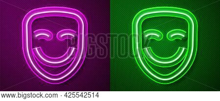 Glowing Neon Line Comedy Theatrical Mask Icon Isolated On Purple And Green Background. Vector