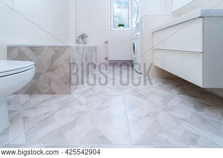 Bathroom After Renovation. New Stone Tiles On The Bath Room Floor. Home Renovation And Improvement C