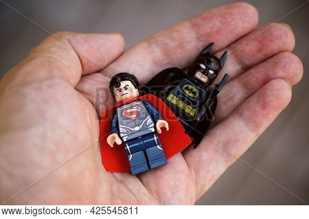 Tambov, Russian Federation - May 28, 2021 Lego Superman And Batman Minifigures In Person Hand. Focus