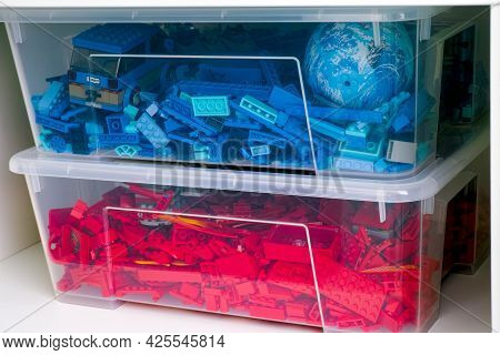 Tambov, Russian Federation - June 12, 2021 Plastic Containers Full Of Red And Blue Lego Blocks, Bric