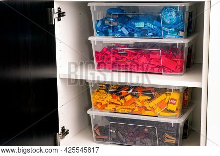 Tambov, Russian Federation - June 12, 2021 Plastic Containers Full Of Blue, Red, Yellow And Brown Le