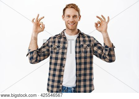 Confident Adult Redhead Man Showing Yes Ok Okay Gesture And Smiling Happy, Guarantee Everything Unde
