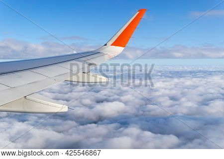 Wing Airplane By Airplane Window Frame, Concept Travel And Freedom.