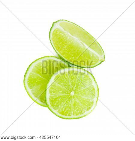 Fresh Green Juicy Limes And Lime Slices Isolated On White Background.