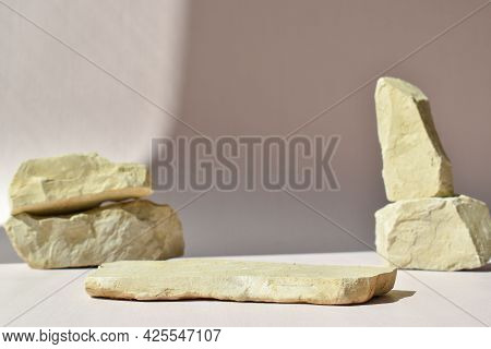 Minimalistic Scene Of A Lying Stone On A Background Of Stones. Catwalk For The Presentation Of Produ
