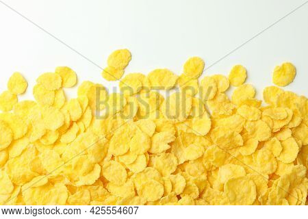 Dry Uncooked Corn Flakes On White Background, Close Up