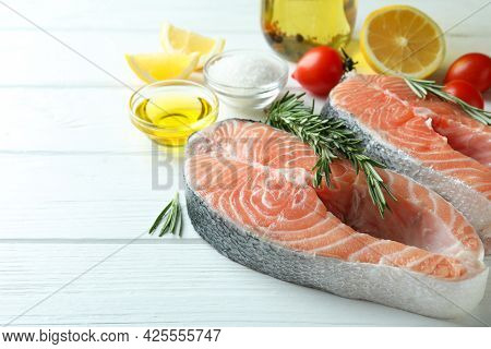 Concept Of Cooking Salmon On White Wooden Table