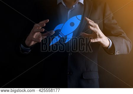 Start Up Concept With Businessman Holding Abstract Digital Rocket Icon Rocket Is Launching And Soar