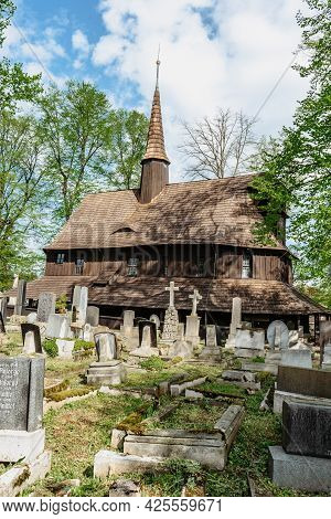 Broumov, Czech Republic - May 21, 2021. Wooden Church Of St. Mary From 13th Century With Old Cemeter