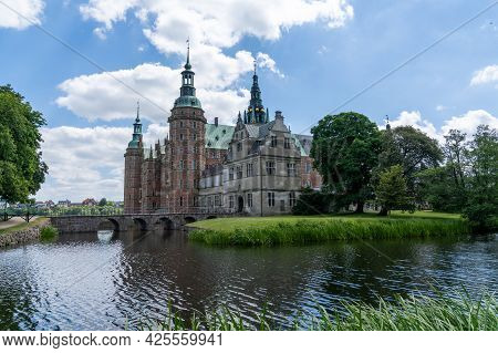 Hillerod, Denmark - 16 June, 2021: View Of The Frederiksborg Castle In Hillerod On A Beautiful Summe