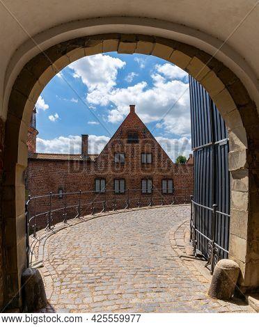 Hillerod, Denmark - 16 June, 2021: Arched Gate And Entrance At The Frederiksborg Slot In Hillerod