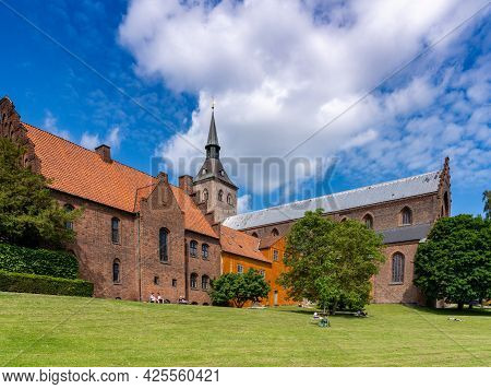 Odense,denmark - 9 June, 2021: The City Park And Cathedral Of Saint Canute In Odense