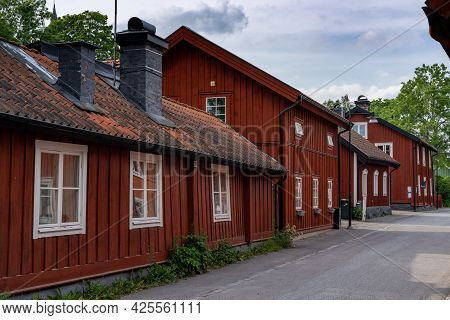 Trosa, Sweden - 22 June, 2021: Typical Red Swedish Wooden Houses Line The Streets Of The Historic Ci