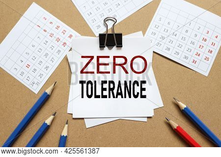 Zero Tolerance. The Text On The Sticker Near The Calendar And Karagdash. The Paper Is Clamped With A