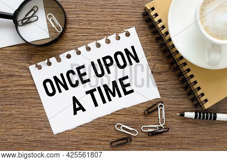 Once Upon A Time. Text On Wood Table, On White Paper