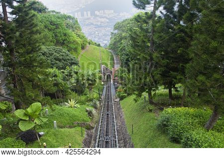 The Penang Hill Tram Tracks And The City Of Air Itam, Penang Malaysia Seen From An Aerial View From