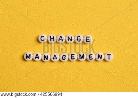 Alphabet Letters With Text Change Management Isolated On Yellow Background