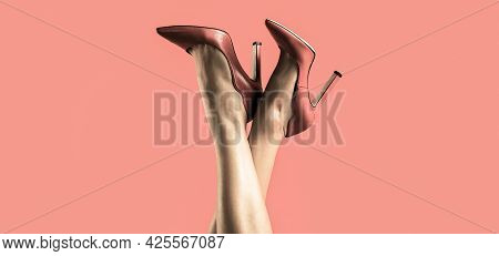 Pretty Female Legs With Red High Heels On Red Background. Perfect Female Legs Wearing High Heels. Sh