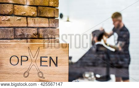 Man Visiting Hairstylist In Barber Shop. Man With Beard In Barber Shop. Open Barbershop Salon. Moder
