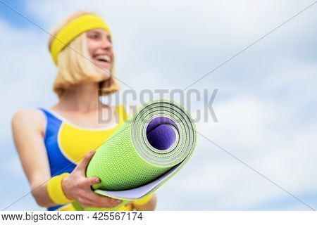 Woman In Sports Wear Is Holding A Yoga Mat And A Bottle Of Water. Yoga Mat And Water Bottle. Healthy
