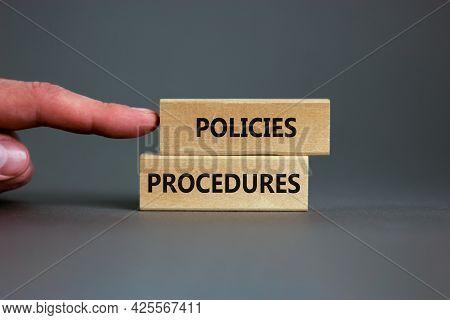 Policies And Procedures Symbol. Wooden Blocks With Concept Words Policies Procedures On Grey Backgro