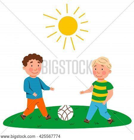 Children Play Football. The Boys Kick The Ball.