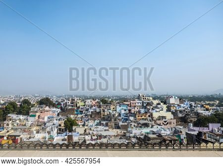 Panoramic view of a dense city of Udaipur, Rajasthan. Aerial view of Indian urban city or town.
