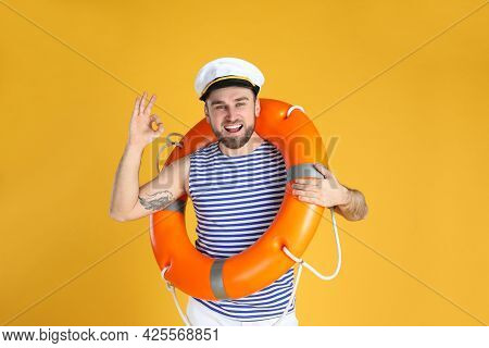 Happy Sailor With Ring Buoy On Yellow Background