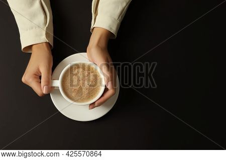Coffee Causing Dental Problem. Woman With Cup Of Hot Drink On Black Background, Top View