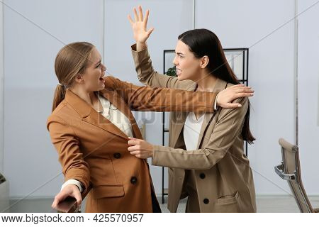 Emotional Colleagues Fighting In Office. Workplace Conflict