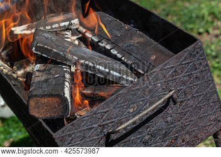 Ready For Frying Firewood Is Burning In A Brazier. The Preparation Of Cooking Meat For Barbecue