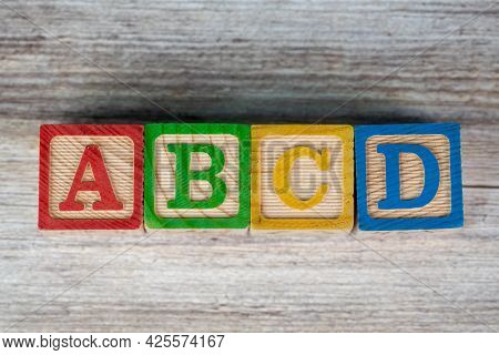 Abcd Letter Education Wood Block On Table.