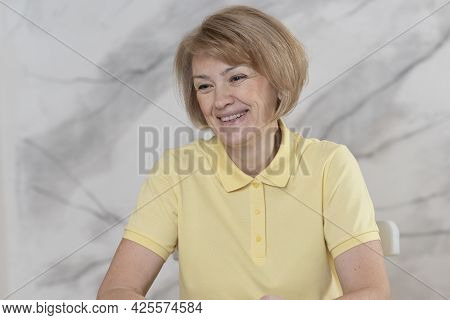 Portrait Of Beautiful Happy Positive Cheerful Woman, Elderly Senior Mature Lady Is Smiling, Laughing