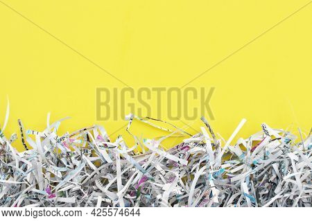 Shredded Paper On Light Yellow Background. Selective Focus Image.