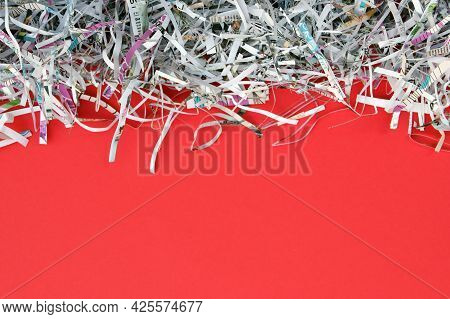 Shredded Paper On Red Background. Selective Focus Image.