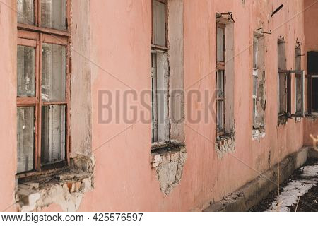 Windows Of Abandoned Buildings Collapsed House In Town In Spring Close Up.