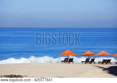 Empty Beach Background With Bright Tents, Chairs, Surf Waves And Sunny Sky, Nobody
