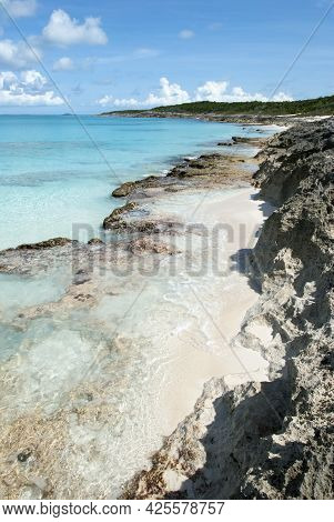 The Aerial View Of Rocky Coastline And Transparent Waters On Half Moon Cay (bahamas).