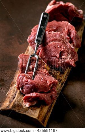 Fresh Whole Raw Beef Tenderloin On Wooden Board