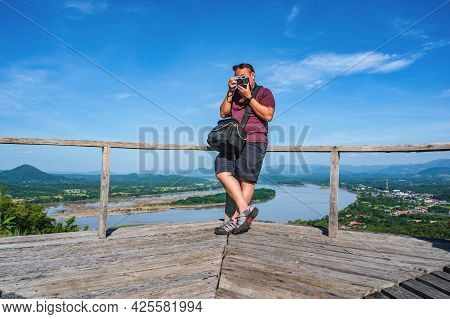 Asian Fat Guy Takeing Photo Post With Beautiful Landscape View On Phu Lamduan At Loei Thailand.phu L