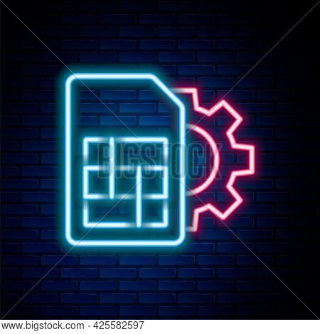 Glowing Neon Line Sim Card Setting Icon Isolated On Brick Wall Background. Mobile Cellular Phone Sim