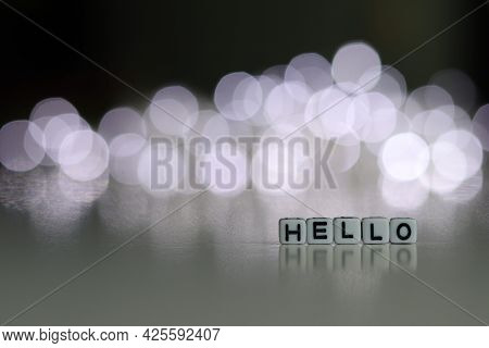 Hello Text On White Cubic Blocks. The Letters Are Written On The Cubes In Black Letters Highlighted