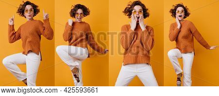 Singing Girl In Fashionable Winter Attire Dancing With Gray Purse Posing On Purple Background. Indoo