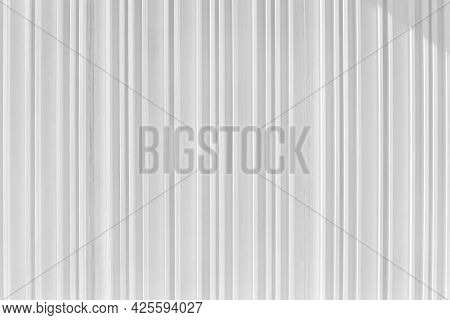 Decorative Concrete Vertical Groove Pattern Of A Building Facade. Grooved White Cement Background