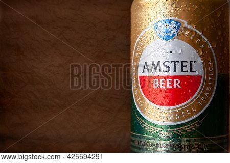 Beer Can With Water Drops. Amstel Beer In Can Close-up Covered With Condensation. World Famous Dutch