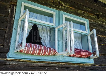 Pillows In The Window. Open-air Museum In Stara Lubovna, Slovak Republic. Architectural Theme.