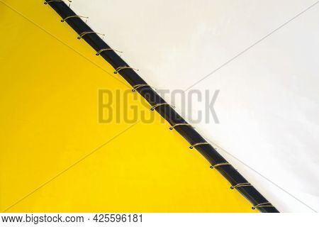 Part Of Yellow-white Decorative Ceiling, Fabric Drapery. Interior Design, Abstract Background. Copy
