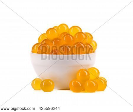 Yellow Tapioca Pearls For Bubble Tea Isolated On White Background. Tapioca Pearls In White Ceramic B