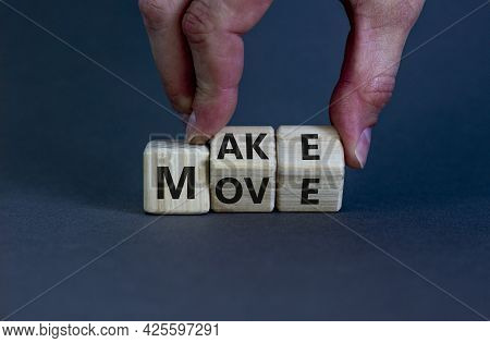 Make Your Move Symbol. Businessman Turns Wooden Cubes With Words 'make Move'. Beautiful Grey Backgro
