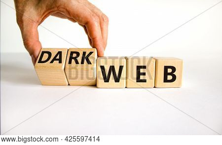 Dark Web Symbol. Businessman Turns Wooden Cubes And Changes The Word Web To Dark Web. Beautiful Whit